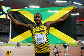 Usain Bolt of Jamaica celebrates after winning gold in the Men's 200 metres final during day six of the 15th IAAF World Athletics Championships...