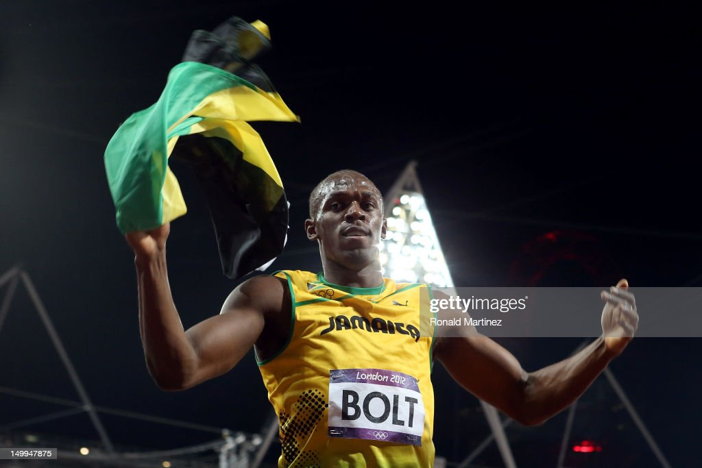 <a gi-track='captionPersonalityLinkClicked' href=/galleries/search?phrase=Usain+Bolt&family=editorial&specificpeople=604196 ng-click='$event.stopPropagation()'>Usain Bolt</a> of Jamaica celebrates after winning the gold medal in the Men's 100m Final on Day 9 of the London 2012 Olympic Games at the Olympic Stadium on August 5, 2012 in London, England.