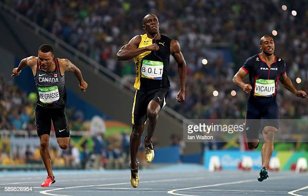 Usain Bolt of Jamaica celebrates after winning the Mens 100m final on Day 9 of the Rio 2016 Olympic Games at the Olympic Stadium on August 14 2016 in...