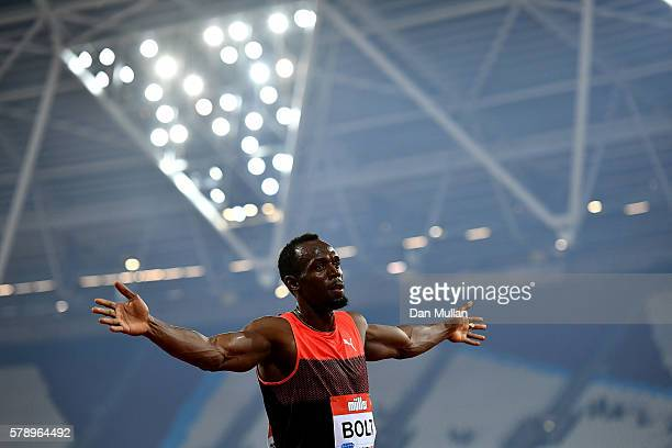 Usain Bolt of Jamaica celebrates after winning the mens 200m during Day One of the Muller Anniversary Games at The Stadium Queen Elizabeth Olympic...