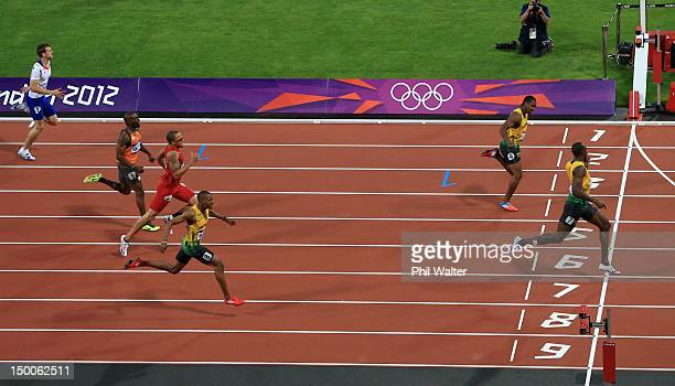 Usain Bolt of Jamaica celebrates as he crosses the finish line ahead of Christophe Lemaitre of France Churandy Martina of Netherlands Wallace...