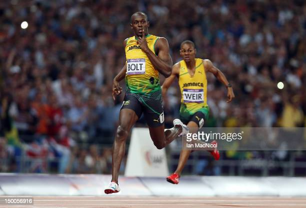 Usain Bolt of Jamaica celebrates as he crosses the finish line to win gold during the Men's 200m Final on Day 13 of the London 2012 Olympic Games at...