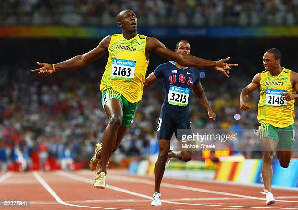 Usain Bolt of Jamaica celebrates as he crosses the line in the Men's 100m Final at the National Stadium on Day 8 of the Beijing 2008 Olympic Games on...