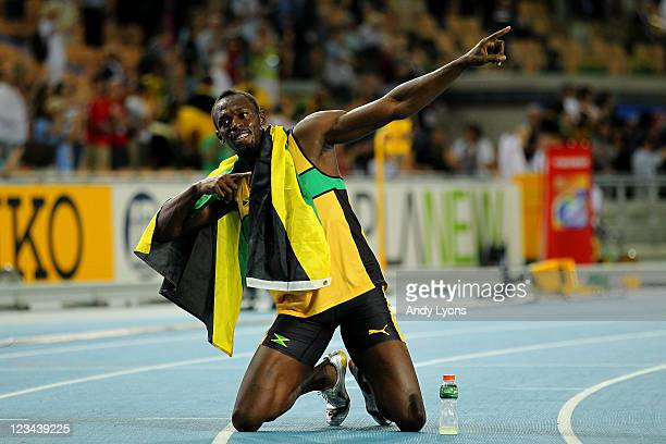 Usain Bolt of Jamaica celebrates claiming gold in the men's 200 metres final during day eight of the 13th IAAF World Athletics Championships at the...