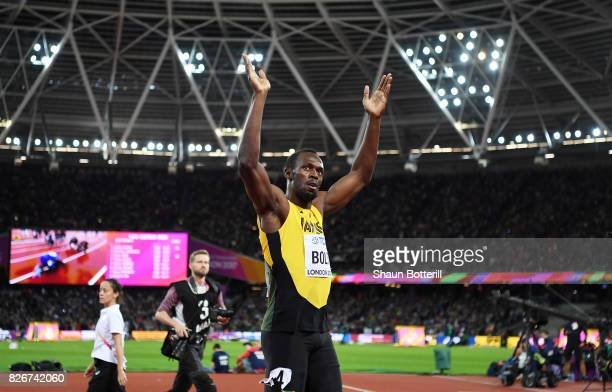 Usain Bolt of Jamaica celebrates finishing in third following the mens 100m final during day two of the 16th IAAF World Athletics Championships...