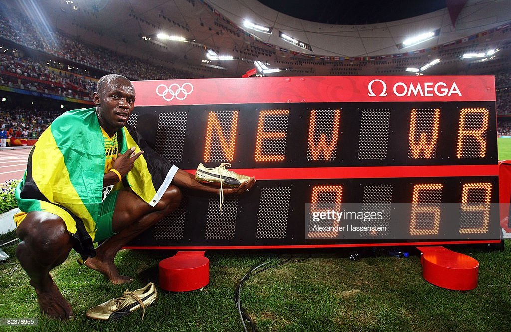 Usain Bolt of Jamaica celebrates next to the scoreboard winning the Men's 100m Final and the gold medal at the National Stadium on Day 8 of the Beijing 2008 Olympic Games on August 16, 2008 in Beijing, China. Usain Bolt of Jamaica finished the event in first place with a time of 9.69, a new World Record.