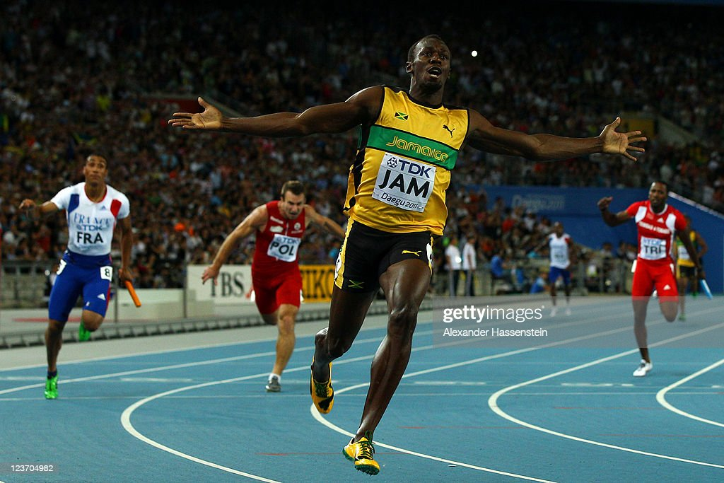 Usain Bolt of Jamaica celebrates victory and a new world record after crossing the finish line in the men's 4x100 metres relay final during day nine of 13th IAAF World Athletics Championships at Daegu Stadium on September 4, 2011 in Daegu, South Korea.
