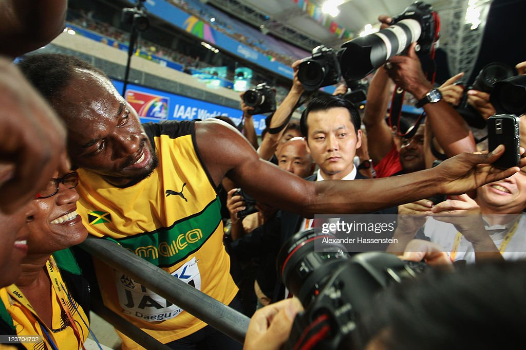 Usain Bolt of Jamaica celebrates victory and a new world record with his mother Jennifer Bolt following the men's 4x100 metres relay final during day nine of 13th IAAF World Athletics Championships at Daegu Stadium on September 4, 2011 in Daegu, South Korea.