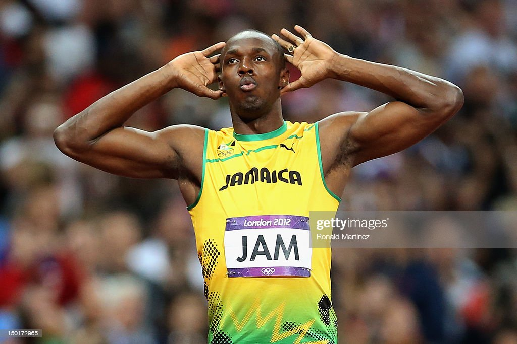 <a gi-track='captionPersonalityLinkClicked' href=/galleries/search?phrase=Usain+Bolt&family=editorial&specificpeople=604196 ng-click='$event.stopPropagation()'>Usain Bolt</a> of Jamaica celebrates winning gold and setting a new world record of 36.84 during the Men's 4 x 100m Relay Final on Day 15 of the London 2012 Olympic Games at Olympic Stadium on August 11, 2012 in London, England.