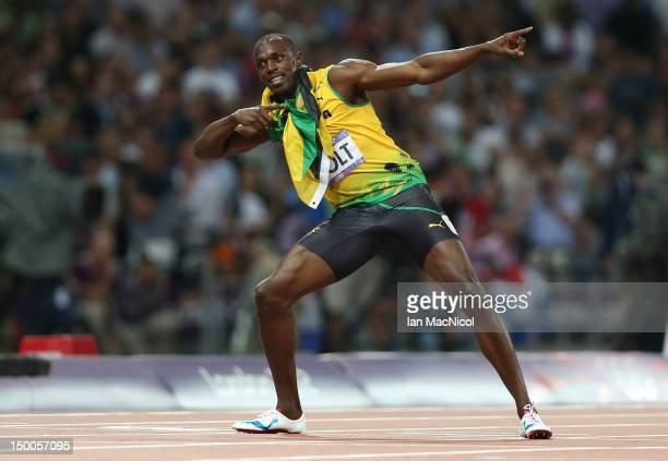 Usain Bolt of Jamaica celebrates winning gold during the Men's 200m Final on Day 13 of the London 2012 Olympic Games at Olympic Stadium on August 9...