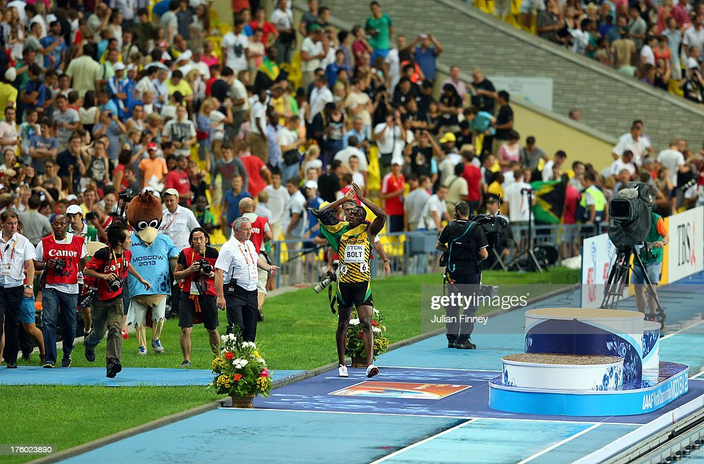 <a gi-track='captionPersonalityLinkClicked' href=/galleries/search?phrase=Usain+Bolt&family=editorial&specificpeople=604196 ng-click='$event.stopPropagation()'>Usain Bolt</a> of Jamaica celebrates winning gold in the Men's 100 metres Final during Day Two of the 14th IAAF World Athletics Championships Moscow 2013 at Luzhniki Stadium on August 11, 2013 in Moscow, Russia.