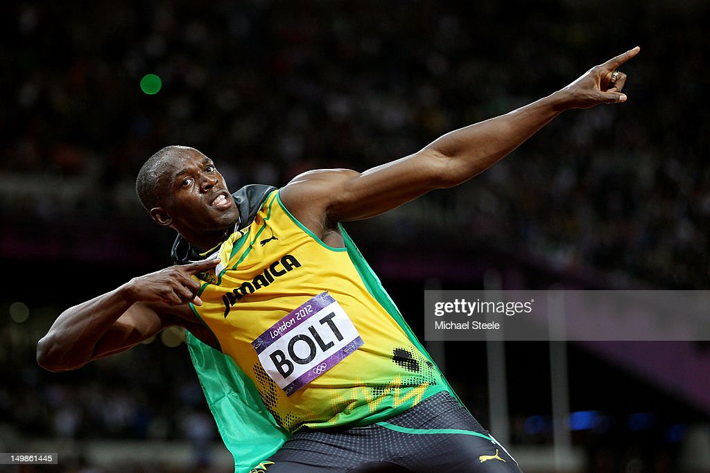 Usain Bolt of Jamaica celebrates winning gold in the Men's 100m Final on Day 9 of the London 2012 Olympic Games at the Olympic Stadium on August 5, 2012 in London, England.
