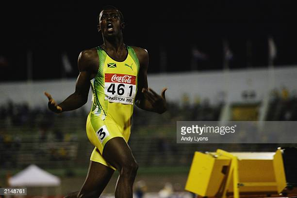 Usain Bolt of Jamaica celebrates winning the 200 metres final during the IAAF Junior Athletics World Championships on July18 2002 at the National...