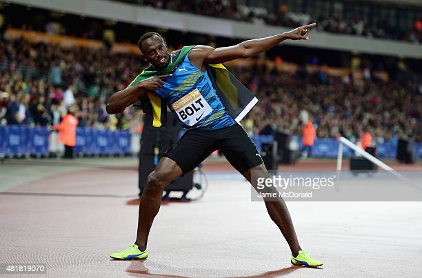 Usain Bolt of Jamaica celebrates winning the Mens 100m final during day one of the Sainsbury's Anniversary Games at The Stadium Queen Elizabeth...