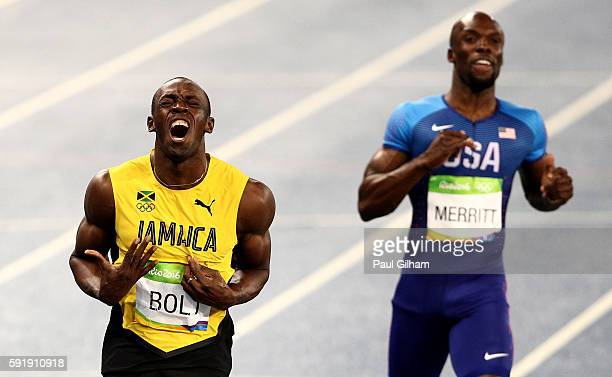 Usain Bolt of Jamaica celebrates winning the Men's 200m Final as Lashawn Merritt of the United States looks on on Day 13 of the Rio 2016 Olympic...