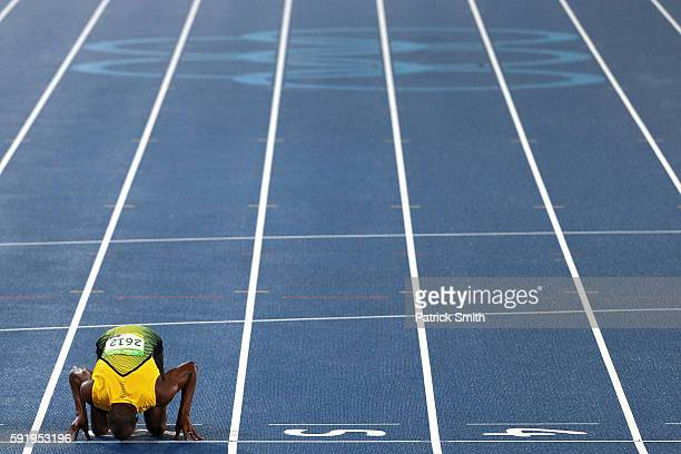 Usain Bolt of Jamaica celebrates winning the Men's 200m Final by kissing the track on Day 13 of the Rio 2016 Olympic Games at the Olympic Stadium on...