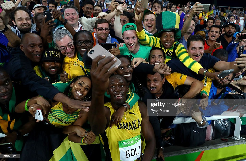 Usain Bolt of Jamaica celebrates with fans after winning the Men's 200m Final on Day 13 of the Rio 2016 Olympic Games at the Olympic Stadium on...