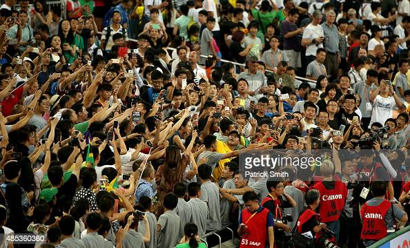 Usain Bolt of Jamaica celebrates with supporters after crossing the finish line to win gold in the Men's 200 metres final during day six of the 15th...