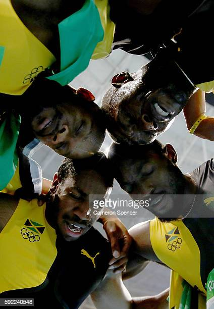 Usain Bolt of Jamaica celebrates with teammates Asafa Powell Yohan Blake and Nickel Ashmeade after winning the Men's 4 x 100m Relay Final on Day 14...