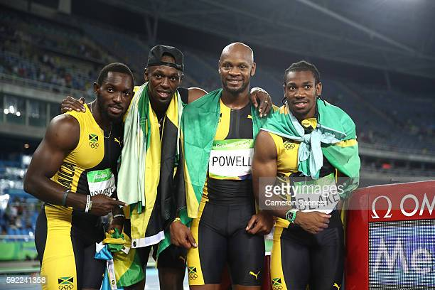 Usain Bolt of Jamaica celebrates with teammates Asafa Powell Yohan Blake and Nickel Ashmeade after they won the Men's 4 x 100m Relay Final on Day 14...