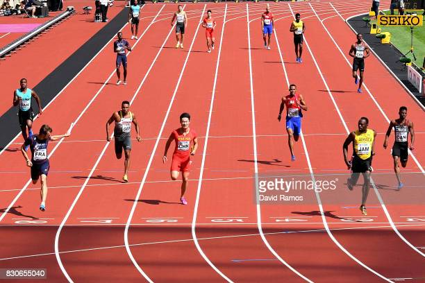Usain Bolt of Jamaica Christophe Lemaitre of France and Peimeng Zhang of China compete in the Men's 4x100 Metres Relay heats during day nine of the...