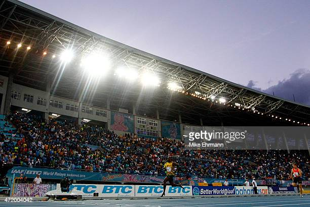Usain Bolt of Jamaica competes during round one of the men's 4 x 100 metres on day one of the IAAF World Relays at Thomas Robinson Stadium on May 2...