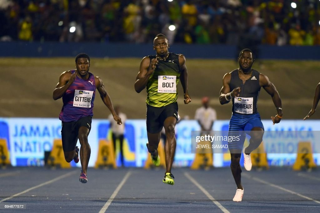 Usain Bolt of Jamaica competes in the 100m 'Salute to a Legend ' race during the Racers Grand Prix at the national stadium in Kingston, Jamaica, on June 10, 2017. Bolt partied with his devoted fans in an emotional farewell at the National Stadium on June 10 as he ran his final race on Jamaican soil. Bolt is retiring in August following the London World Championships. / AFP PHOTO / Jewel SAMAD