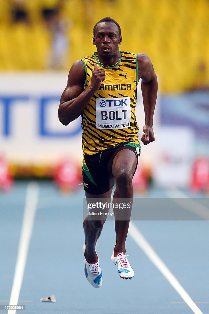 <a gi-track='captionPersonalityLinkClicked' href=/galleries/search?phrase=Usain+Bolt&family=editorial&specificpeople=604196 ng-click='$event.stopPropagation()'>Usain Bolt</a> of Jamaica competes in the Men's 100 metres heats during Day One of the 14th IAAF World Athletics Championships Moscow 2013 at Luzhniki Stadium on August 10, 2013 in Moscow, Russia.