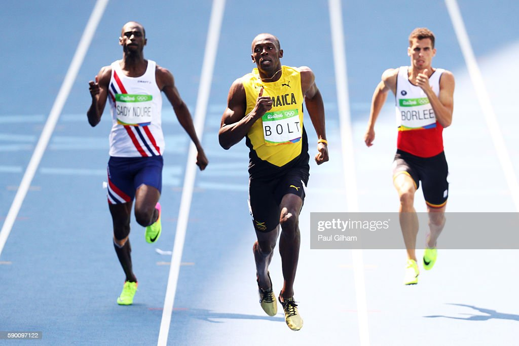 Usain Bolt of Jamaica (C) competes in the Men's 200m Round 1 - Heat 9 on Day 11 of the Rio 2016 Olympic Games at the Olympic Stadium on August 16, 2016 in Rio de Janeiro, Brazil.