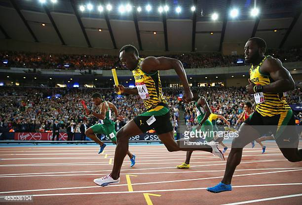 Usain Bolt of Jamaica competes in the Men's 4x100 metres relay heats at Hampden Park during day nine of the Glasgow 2014 Commonwealth Games on August...