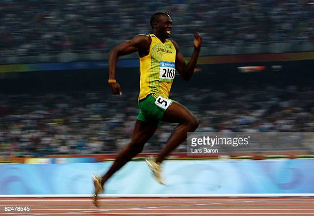 Usain Bolt of Jamaica competes on his way to breaking the world record with a time of 1930 seconds to win the gold medal in the Men's 200m Final at...