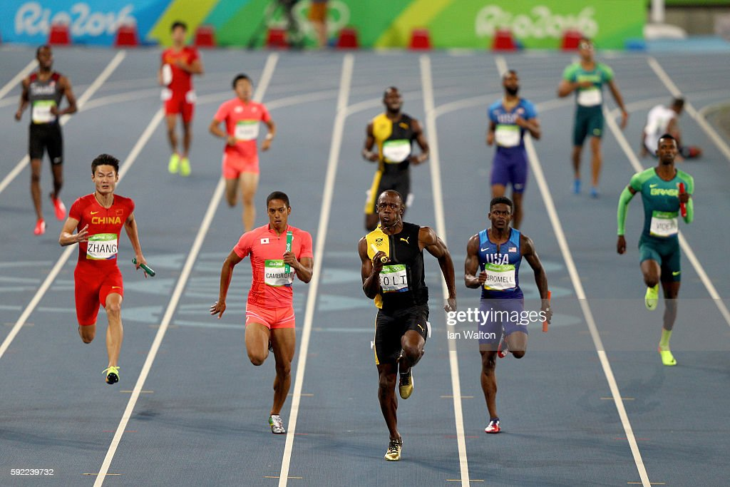Usain Bolt of Jamaica competes on his way to winning ahead of Aska Cambridge of Japan and Trayvon Bromell of the United States in the Men's 4 x 100m Relay Final on Day 14 of the Rio 2016 Olympic Games at the Olympic Stadium on August 19, 2016 in Rio de Janeiro, Brazil.