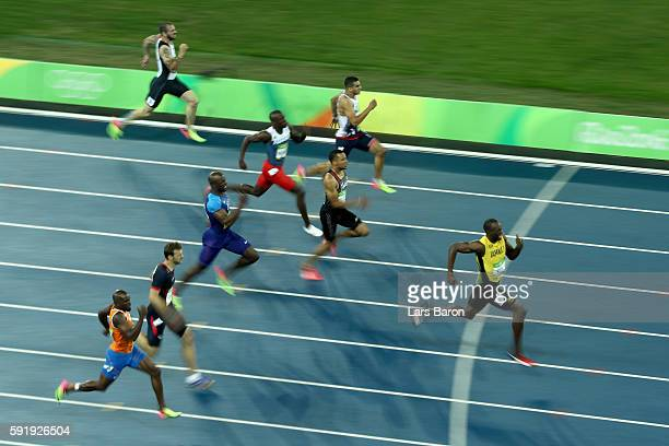 Usain Bolt of Jamaica competes on his way to winning the Men's 200m Final on Day 13 of the Rio 2016 Olympic Games at the Olympic Stadium on August 18...