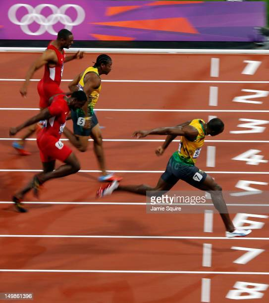 Usain Bolt of Jamaica crosses he line to win gold in the Men's 100m Final on Day 9 of the London 2012 Olympic Games at the Olympic Stadium on August...
