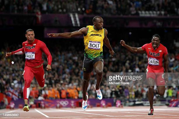 Usain Bolt of Jamaica crosses the finish line ahead of Ryan Bailey of the United States and Justin Gatlin of the United States to win the Men's 100m...