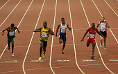Usain Bolt of Jamaica crosses the finish line to win gold ahead of second place Justin Gatlin of the United States and Anaso Jobodwana of South...