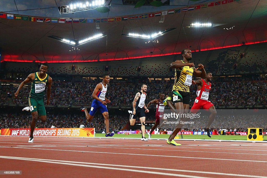 Usain Bolt of Jamaica crosses the finish line to win gold ahead of second place Justin Gatlin of the United States (R) and Anaso Jobodwana of South Africa (L) in the Men's 200 metres final during day six of the 15th IAAF World Athletics Championships Beijing 2015 at Beijing National Stadium on August 27, 2015 in Beijing, China.