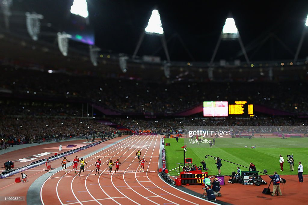 Usain Bolt of Jamaica crosses the finish line to win gold in the Men's 100m Final on Day 9 of the London 2012 Olympic Games at the Olympic Stadium on August 5, 2012 in London, England.