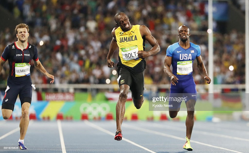 Usain Bolt of Jamaica crosses the finish line to win the men's 200meter final at the Rio de Janeiro Olympics on Aug 18 2016 Christophe Lemaitre of...