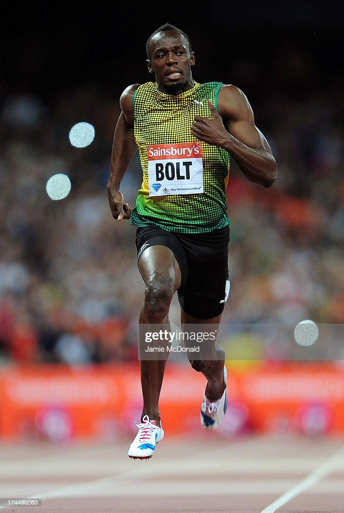 <a gi-track='captionPersonalityLinkClicked' href=/galleries/search?phrase=Usain+Bolt&family=editorial&specificpeople=604196 ng-click='$event.stopPropagation()'>Usain Bolt</a> of Jamaica crosses the line first in the Men's 100m A race on day one during the Sainsbury's Anniversary Games - IAAF Diamond League 2013 at The Queen Elizabeth Olympic Park on July 26, 2013 in London, England.
