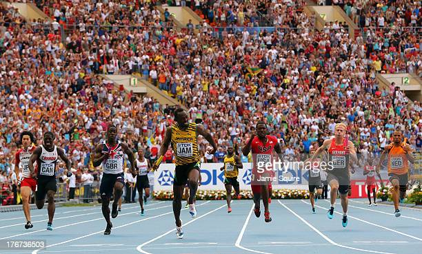 Usain Bolt of Jamaica crosses the line first to win gold ahead of second place Justin Gatlin of the United States third place Justyn Warner of Canada...