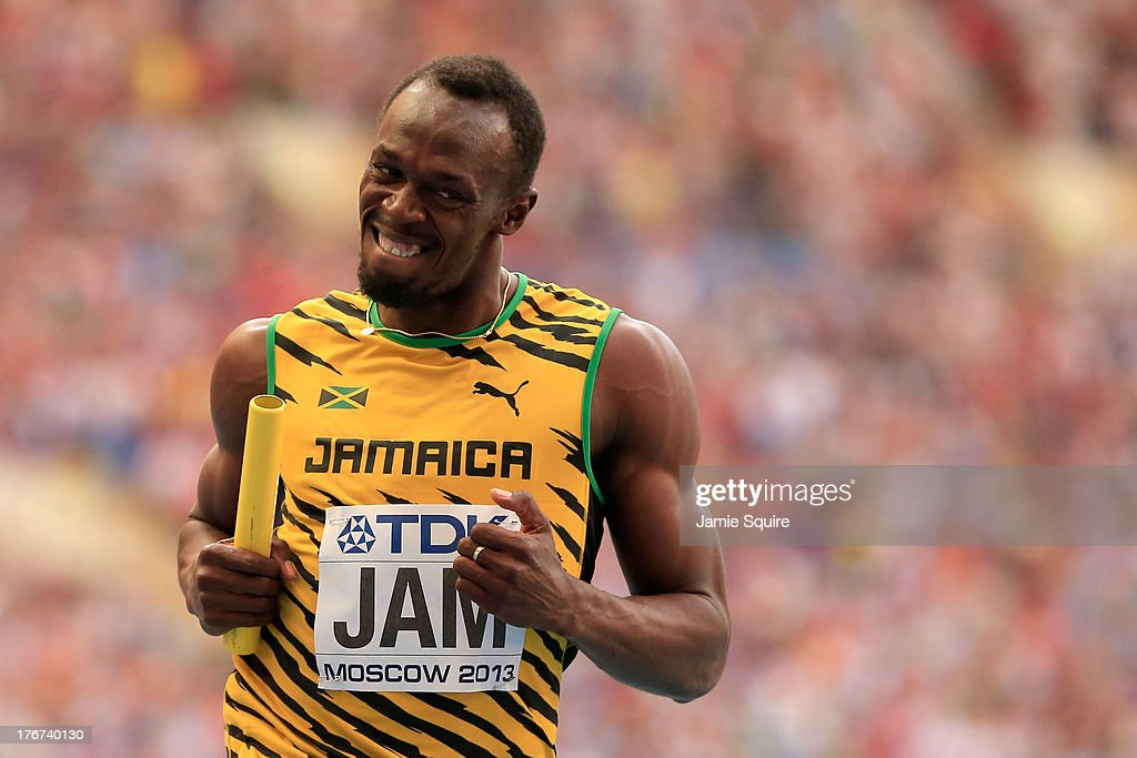 <a gi-track='captionPersonalityLinkClicked' href=/galleries/search?phrase=Usain+Bolt&family=editorial&specificpeople=604196 ng-click='$event.stopPropagation()'>Usain Bolt</a> of Jamaica crosses the line first win gold in the Men's 4x100 metres final during Day Nine of the 14th IAAF World Athletics Championships Moscow 2013 at Luzhniki Stadium on August 18, 2013 in Moscow, Russia.
