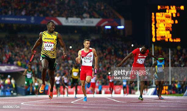Usain Bolt of Jamaica crosses the line to win gold ahead of Danny Talbot of England in the Men's 4x100 metres relay final at Hampden Park during day...
