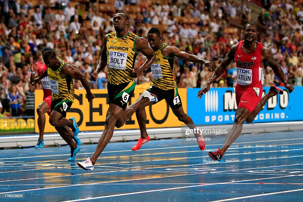 <a gi-track='captionPersonalityLinkClicked' href=/galleries/search?phrase=Usain+Bolt&family=editorial&specificpeople=604196 ng-click='$event.stopPropagation()'>Usain Bolt</a> of Jamaica (C) crosses the line to win gold ahead of <a gi-track='captionPersonalityLinkClicked' href=/galleries/search?phrase=Justin+Gatlin&family=editorial&specificpeople=162752 ng-click='$event.stopPropagation()'>Justin Gatlin</a> of the United States in the Men's 100 metres Final during Day Two of the 14th IAAF World Athletics Championships Moscow 2013 at Luzhniki Stadium on August 11, 2013 in Moscow, Russia.