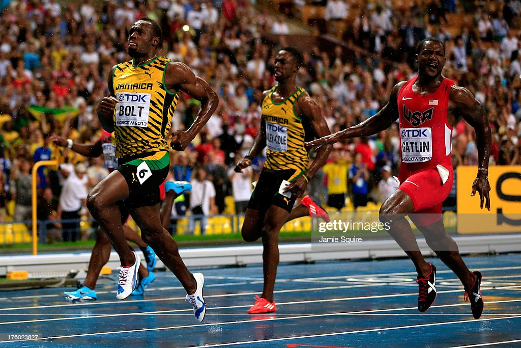 <a gi-track='captionPersonalityLinkClicked' href=/galleries/search?phrase=Usain+Bolt&family=editorial&specificpeople=604196 ng-click='$event.stopPropagation()'>Usain Bolt</a> of Jamaica (C) crosses the line to win gold ahead of <a gi-track='captionPersonalityLinkClicked' href=/galleries/search?phrase=Justin+Gatlin+-+Athlete&family=editorial&specificpeople=162752 ng-click='$event.stopPropagation()'>Justin Gatlin</a> of the United States in the Men's 100 metres Final during Day Two of the 14th IAAF World Athletics Championships Moscow 2013 at Luzhniki Stadium on August 11, 2013 in Moscow, Russia.