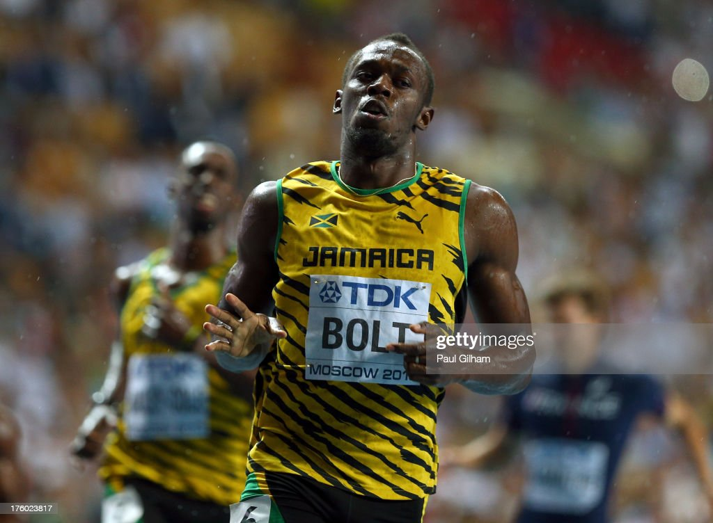 <a gi-track='captionPersonalityLinkClicked' href=/galleries/search?phrase=Usain+Bolt&family=editorial&specificpeople=604196 ng-click='$event.stopPropagation()'>Usain Bolt</a> of Jamaica crosses the line to win gold in the Men's 100 metres Final during Day Two of the 14th IAAF World Athletics Championships Moscow 2013 at Luzhniki Stadium on August 11, 2013 in Moscow, Russia.