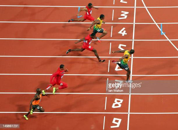Usain Bolt of Jamaica crosses the line to win gold in the Men's 100m Final on Day 9 of the London 2012 Olympic Games at the Olympic Stadium on August...