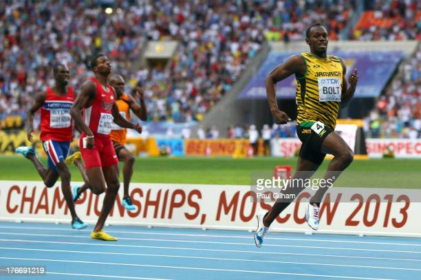 Usain Bolt of Jamaica crosses the line to win gold in the Men's 200 metres final during Day Eight of the 14th IAAF World Athletics Championships...