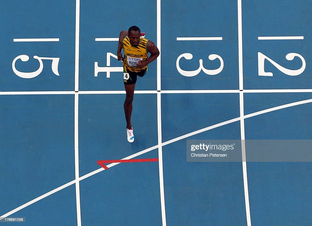 <a gi-track='captionPersonalityLinkClicked' href=/galleries/search?phrase=Usain+Bolt&family=editorial&specificpeople=604196 ng-click='$event.stopPropagation()'>Usain Bolt</a> of Jamaica crosses the line to win gold in the Men's 200 metres final during Day Eight of the 14th IAAF World Athletics Championships Moscow 2013 at Luzhniki Stadium on August 17, 2013 in Moscow, Russia.
