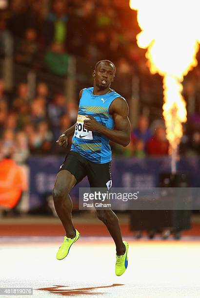 Usain Bolt of Jamaica crosses the line to win the Mens 100m Final during day one of the Sainsbury's Anniversary Games at The Stadium Queen Elizabeth...